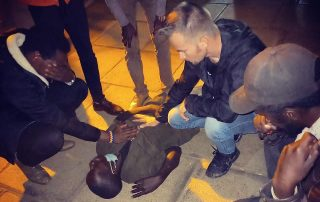 Joshua Lindquist Ministering on the streets of Kenya to a young man